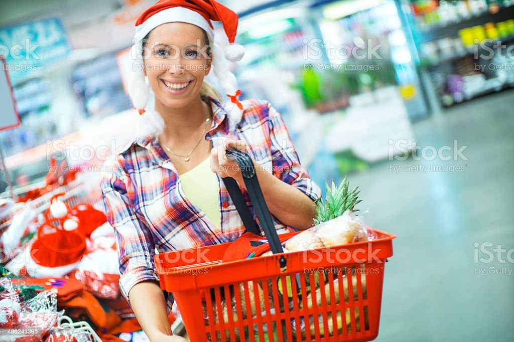 Woman doing grocery shopping in supermarket. stock photo