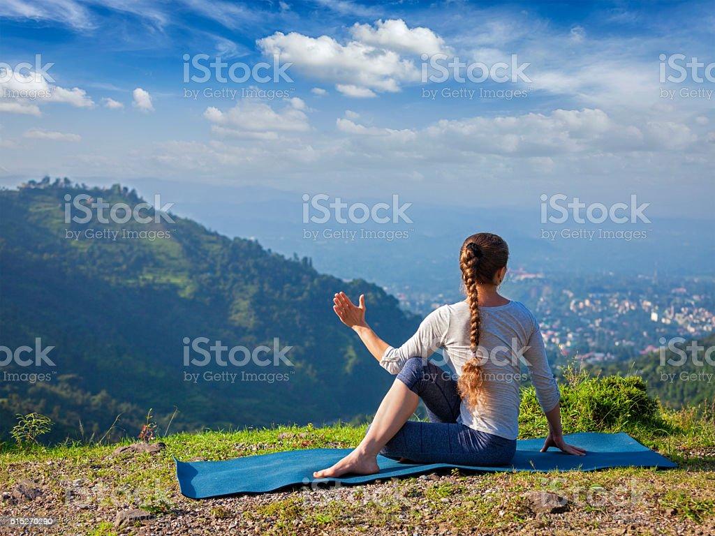 Woman doing Hatha yoga asana outdoors stock photo