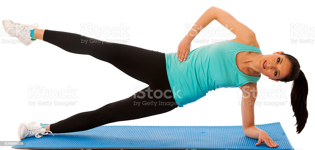 Woman doing hipups in fitness gym isolated over white background stock photo