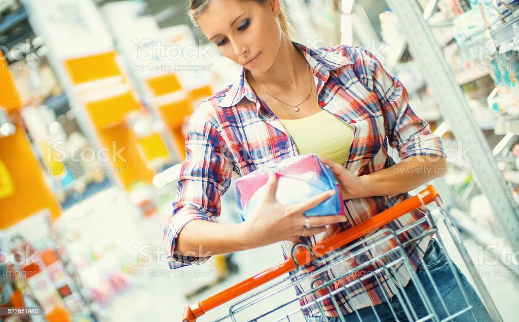 Woman doing home shopping in supermarket. stock photo