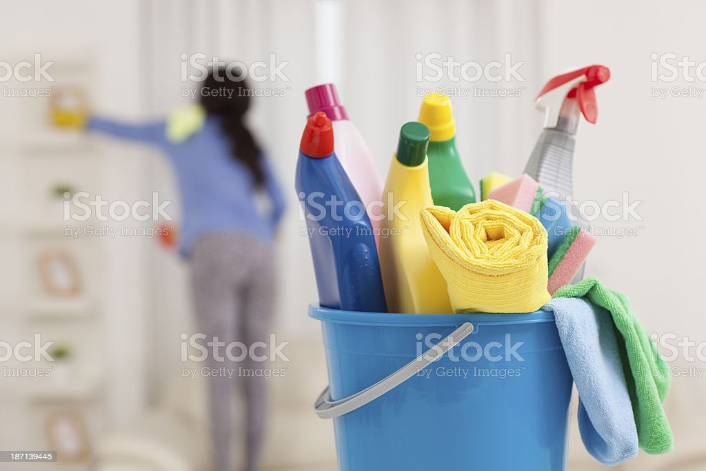 Woman doing housekeeping. stock photo