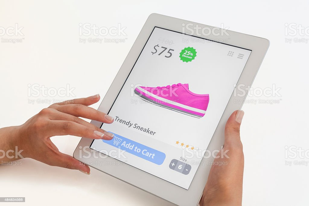 woman doing internet shopping on tablet computer. stock photo