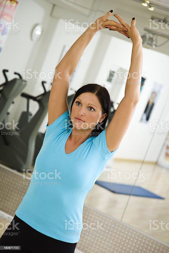Woman Doing Latissimus Dorsi Stretch stock photo