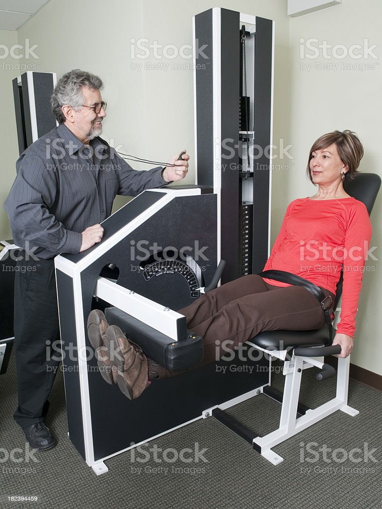 Woman Doing Leg Exercise - Physical Therapy Series stock photo