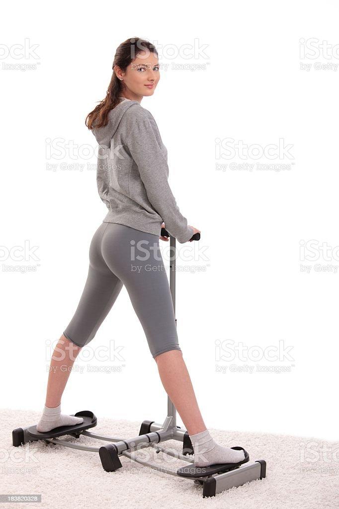 Woman doing leg exercise stock photo