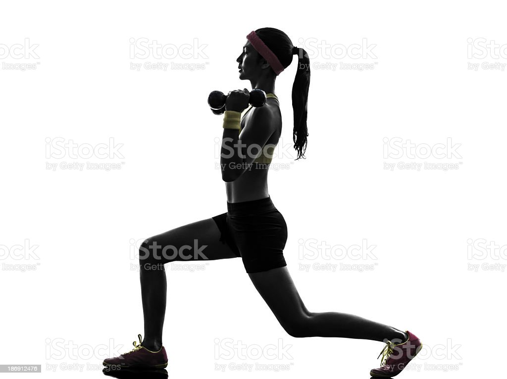 Woman doing lunges with dumbbells with white background  stock photo