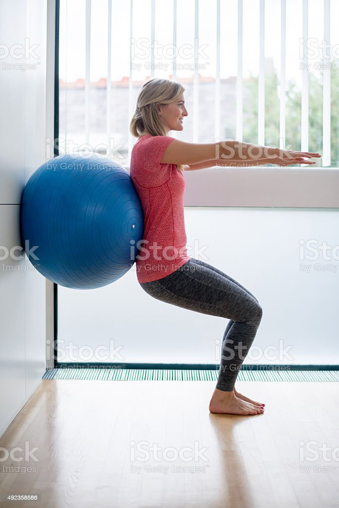 Woman doing Pilates at home stock photo