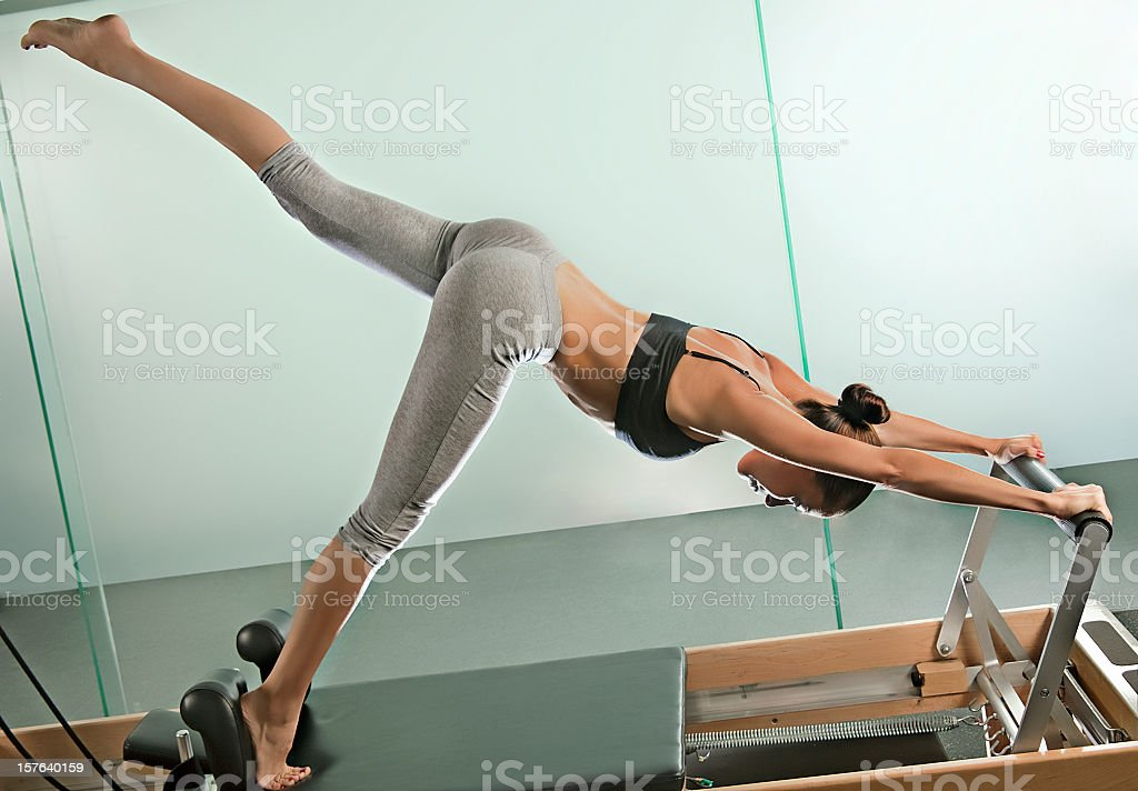 Woman doing pilates exercises in the gym royalty-free stock photo