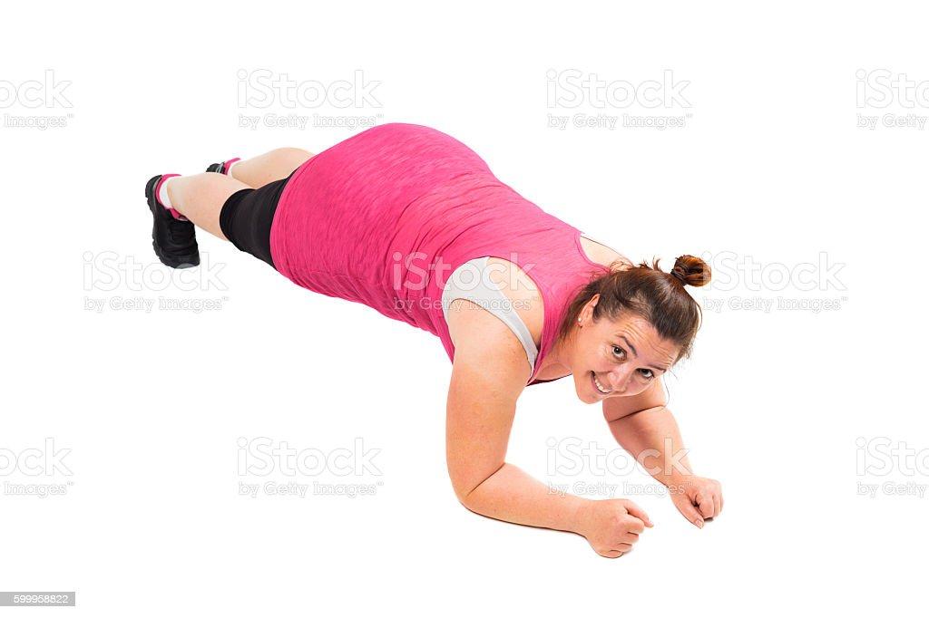Woman doing plank stock photo