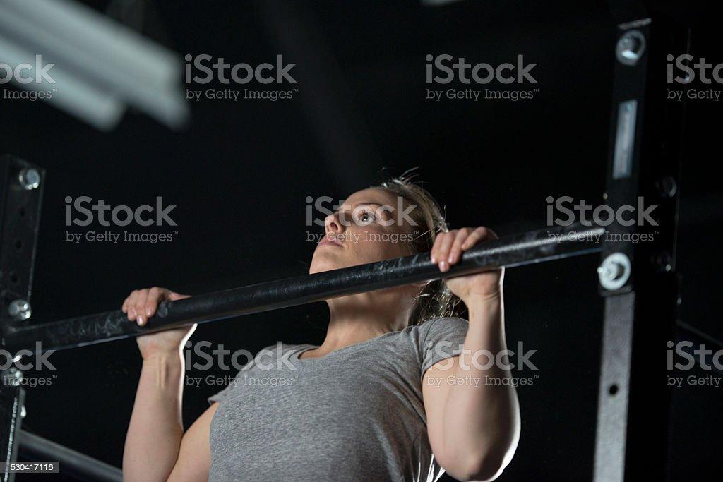 Woman Doing Pull Ups stock photo