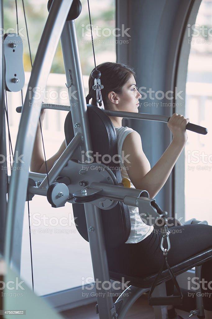 Woman doing pull-ups exercising lifting dumbbells.Cardio and fat loss stock photo