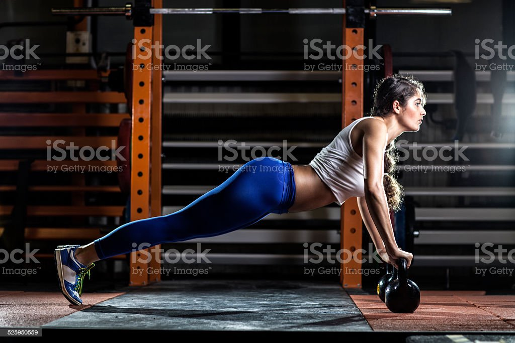 Woman Doing Push Ups At Gym stock photo