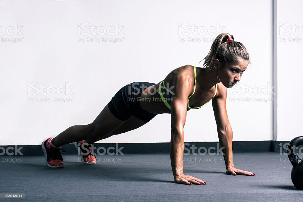 Woman doing push-ups stock photo