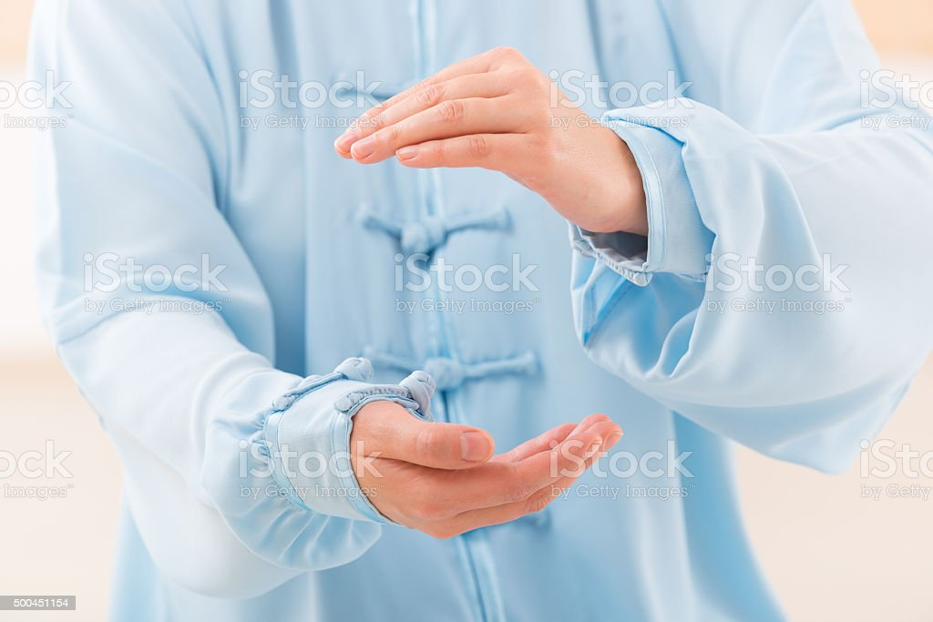 Woman doing qi gong tai chi exercise stock photo