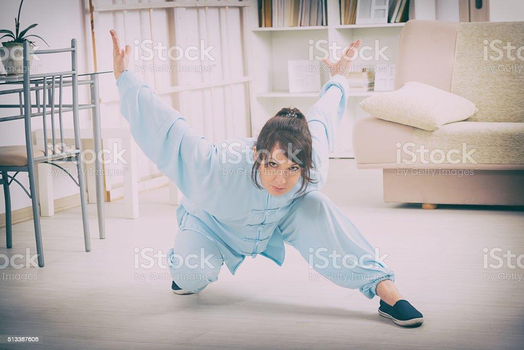 Woman doing qi gong tai chi exercise stock photo