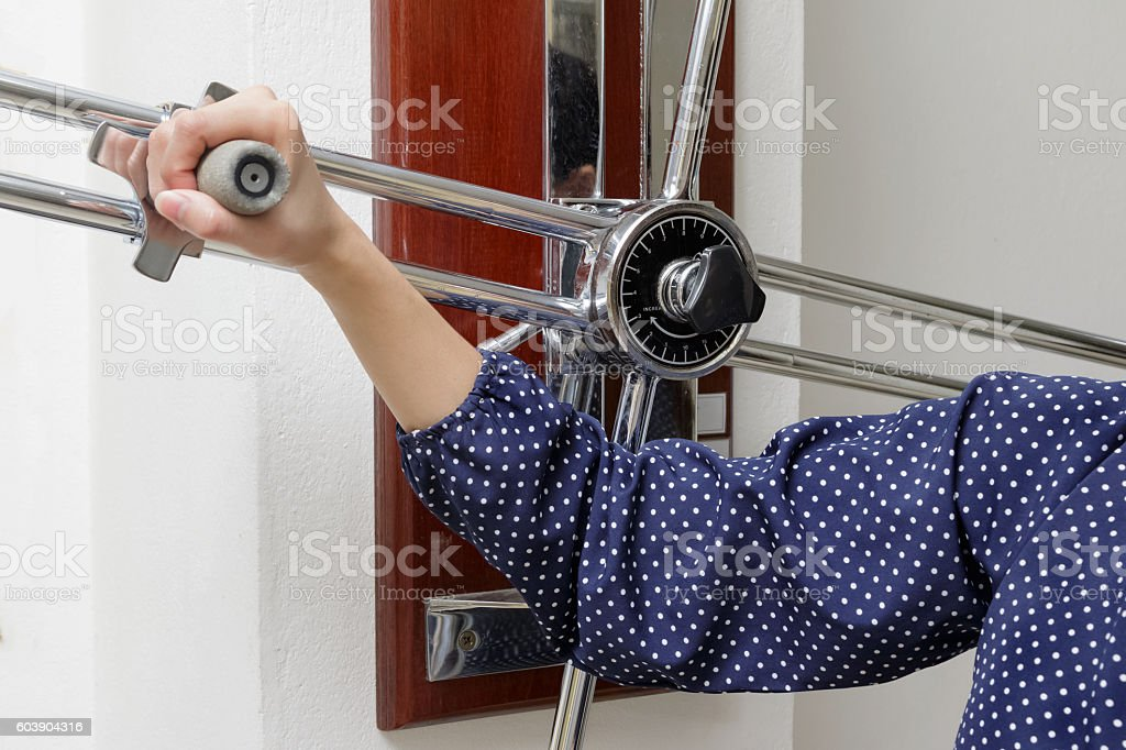 Woman doing rehab exercise with shoulder wheel, physical therapy stock photo