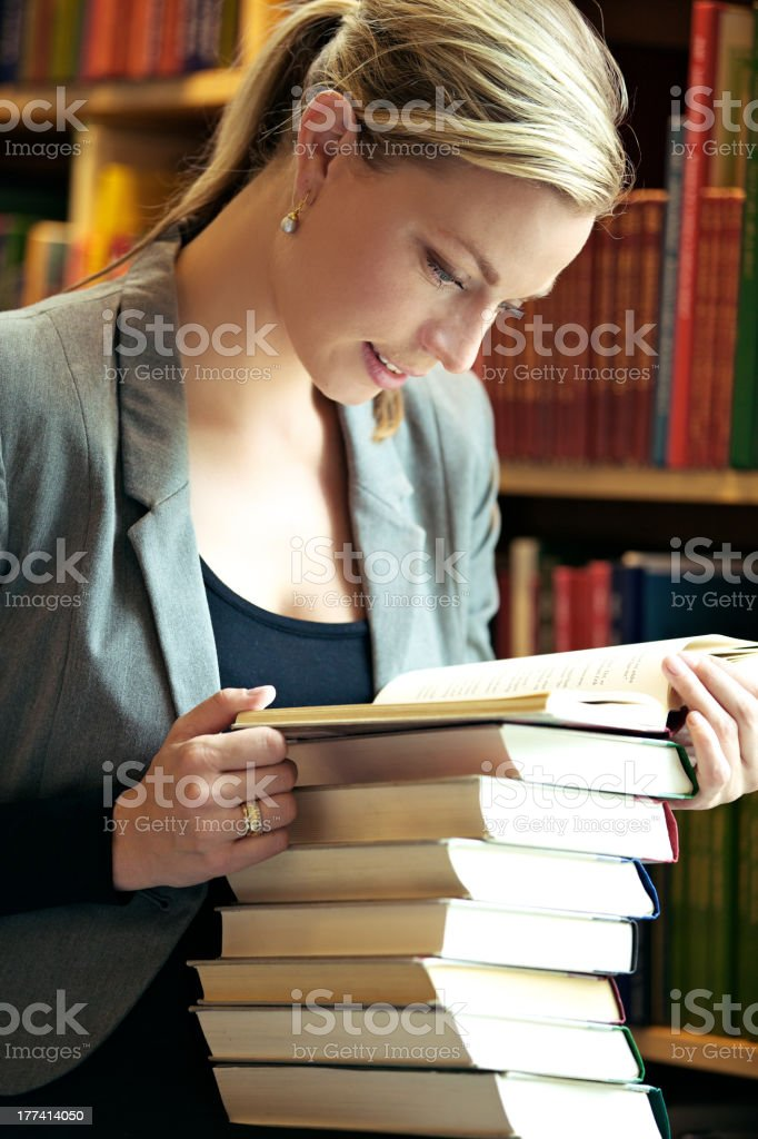 Woman doing research in library royalty-free stock photo