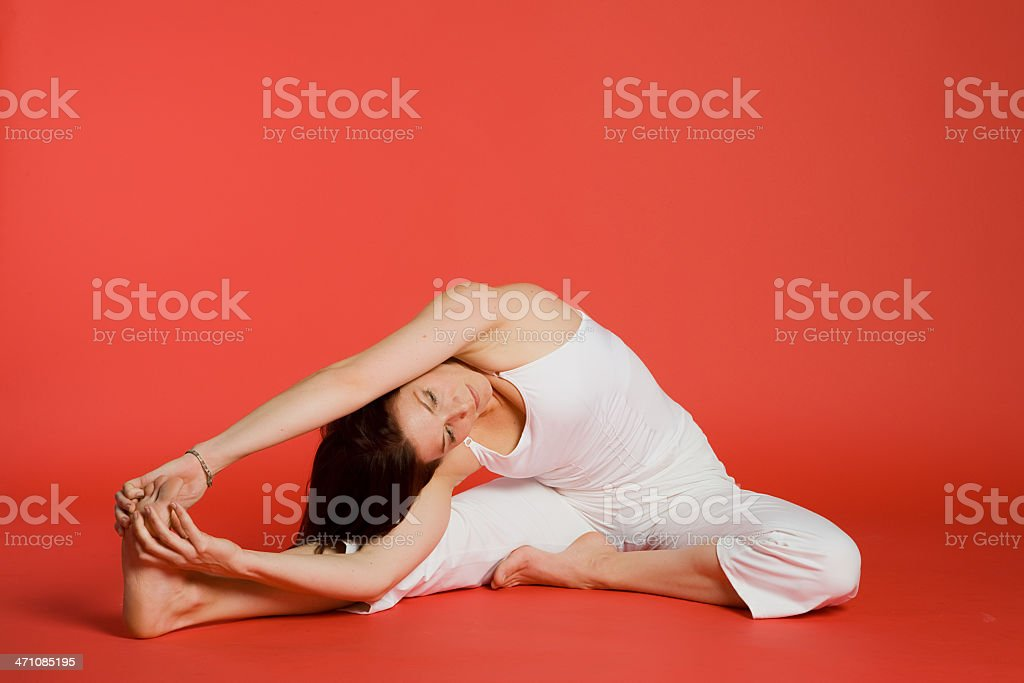 Woman doing revolved seated angle pose royalty-free stock photo