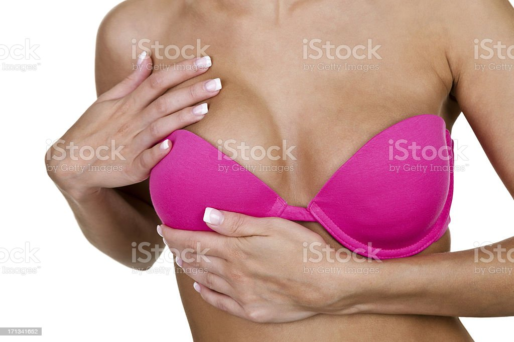 Woman doing self examination stock photo