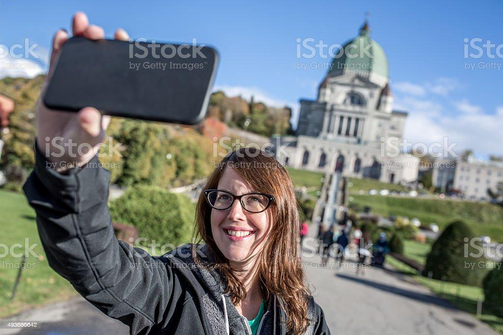 Woman Doing Selfie in Front of Saint Joseph's Oratory, Montreal stock photo