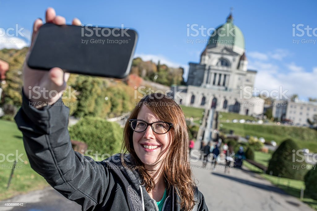 Woman Doing Selfie in Front of Saint Joseph's Oratory, Montreal stock photo