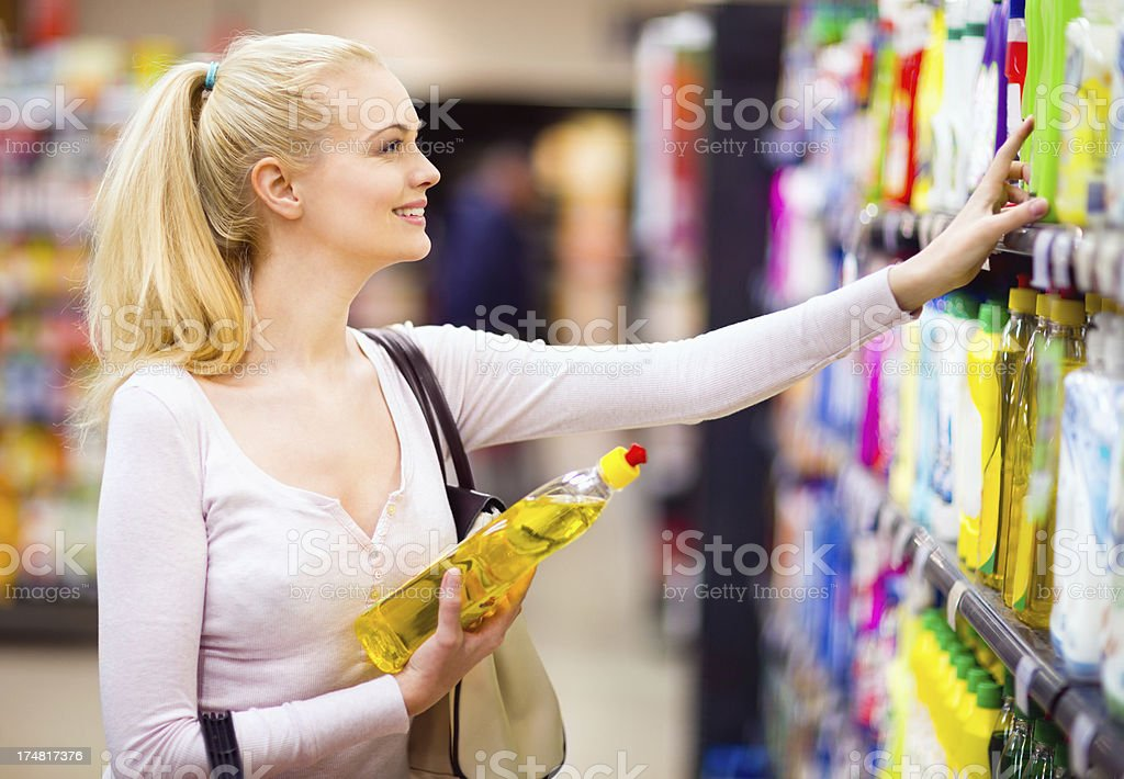 Woman doing shopping in supermarket stock photo
