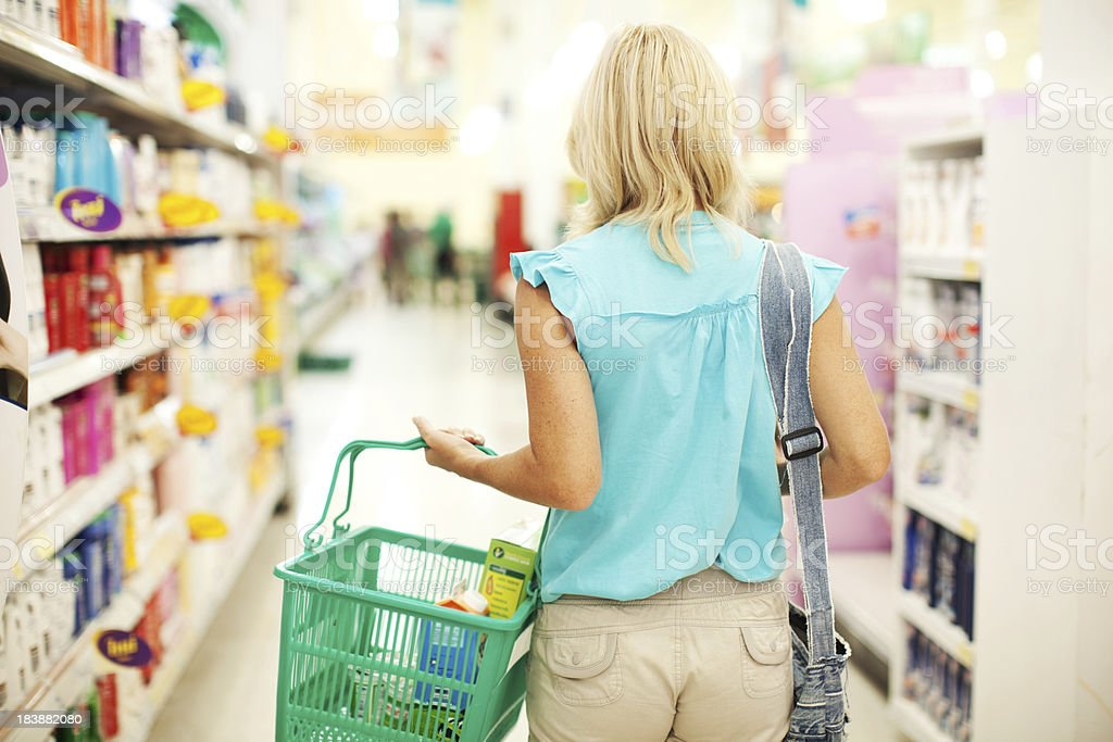 Woman doing shopping of toiletry in the store. stock photo