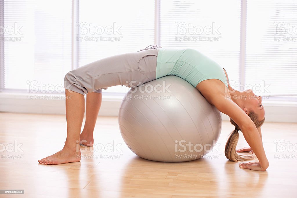 Woman doing sit-ups with fitness ball royalty-free stock photo