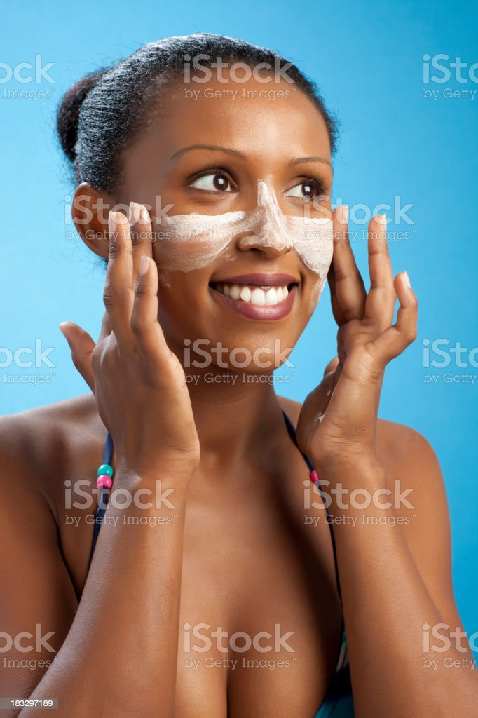 Woman doing skincare treatment in the T zone  royalty-free stock photo