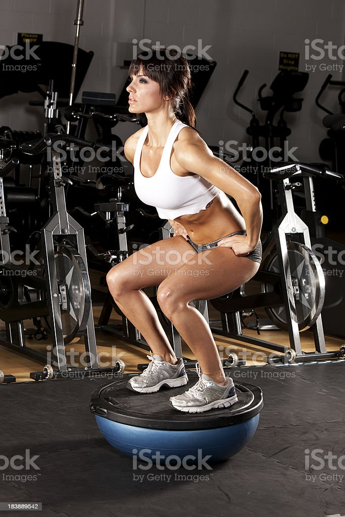 Woman Doing Squats royalty-free stock photo