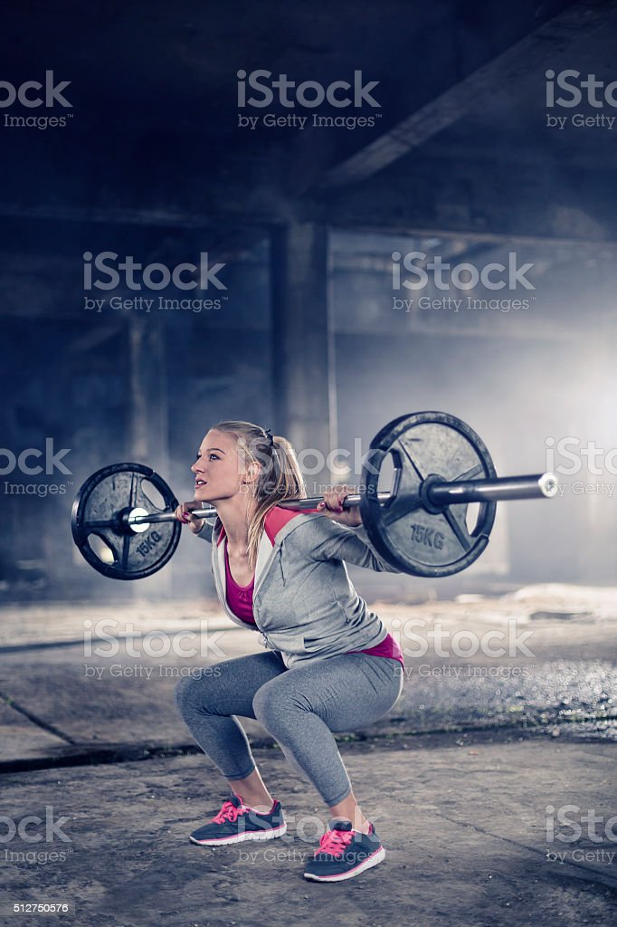 Woman doing squats stock photo