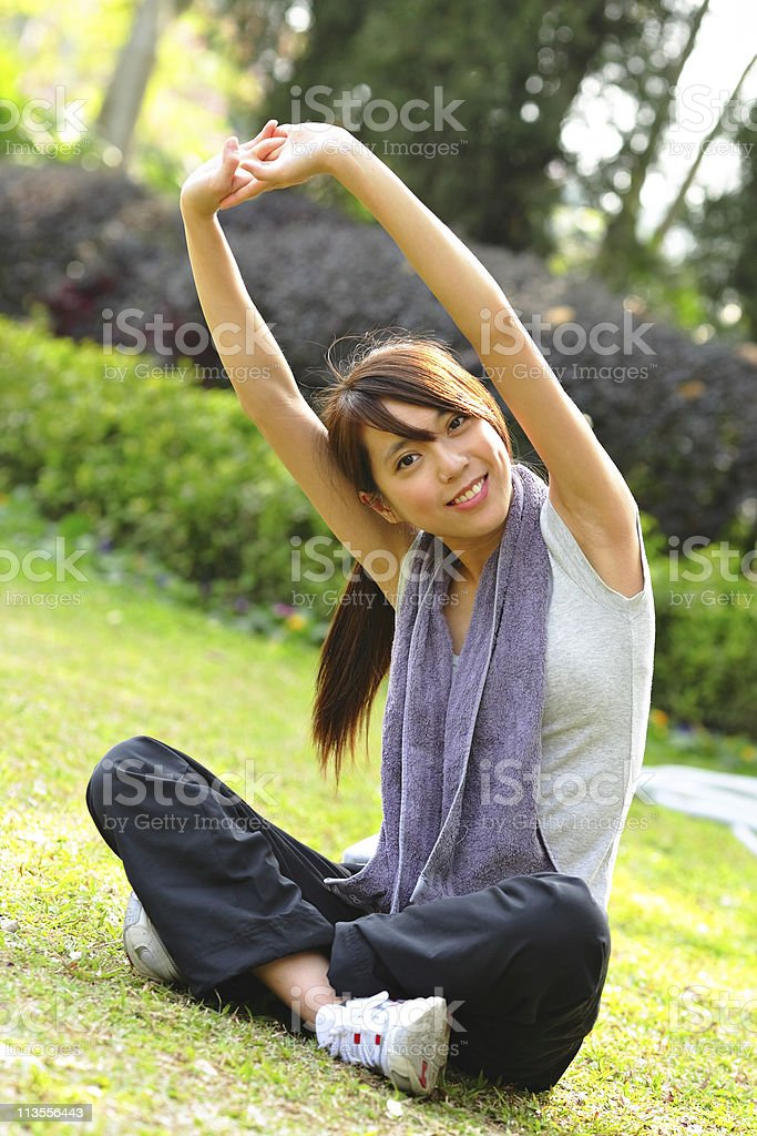 woman doing stretching exercise royalty-free stock photo