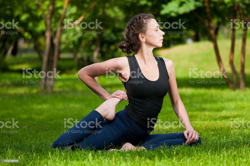 woman doing stretching exercise. Yoga royalty-free stock photo