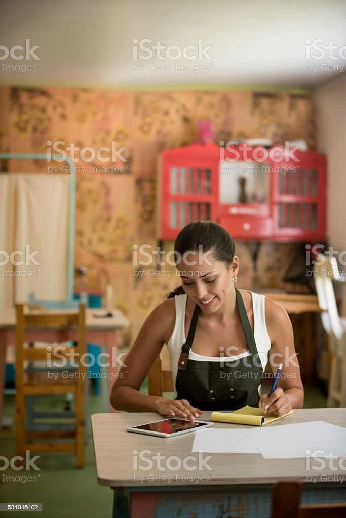 Woman doing the books at her small business stock photo