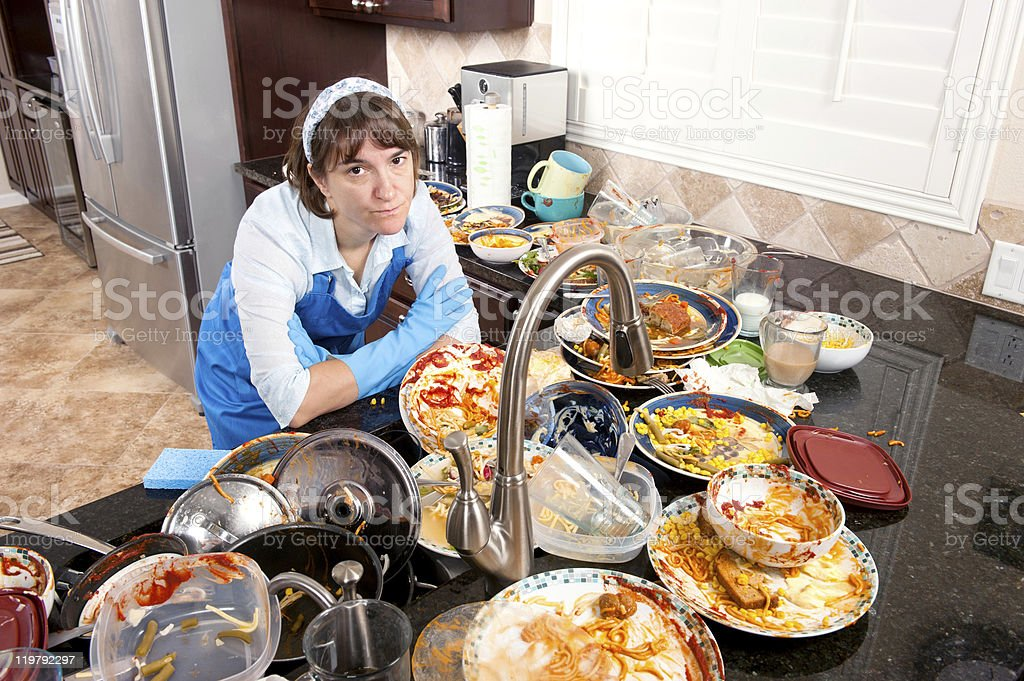 Woman doing the dishes stock photo