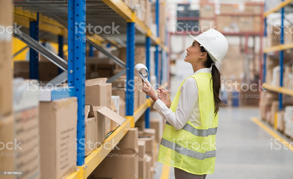 Woman doing the inventory at a warehouse stock photo