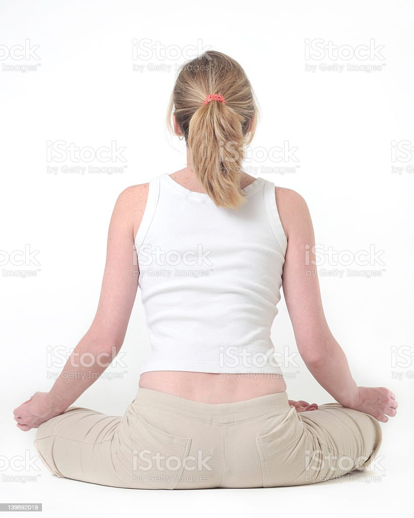 Woman doing the lotus pose in yoga royalty-free stock photo