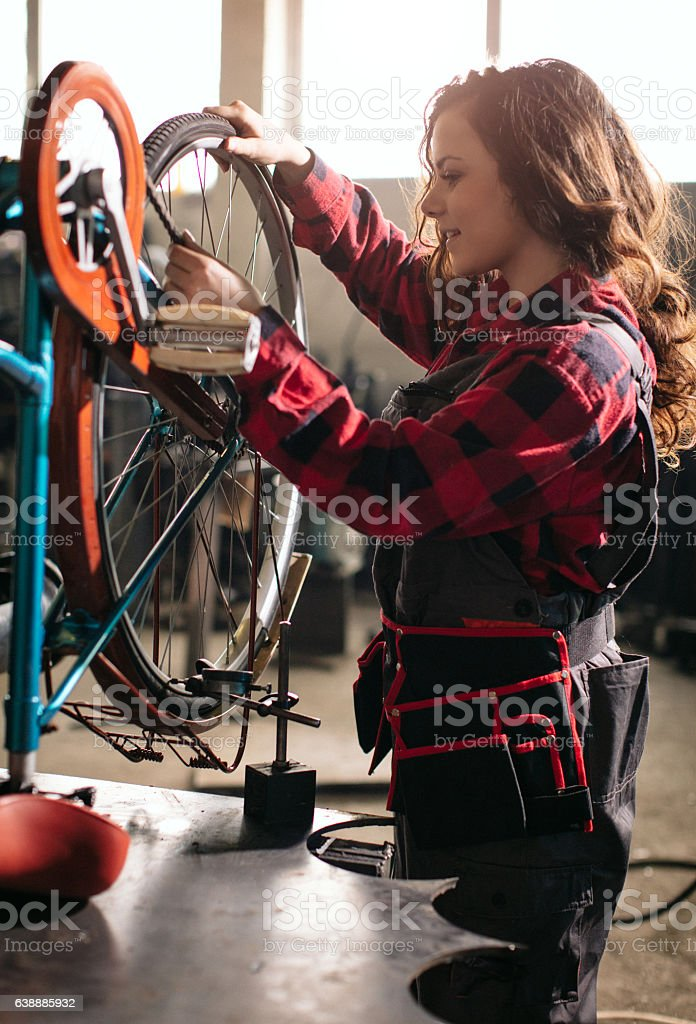 Woman doing work on an equal footing with men... stock photo