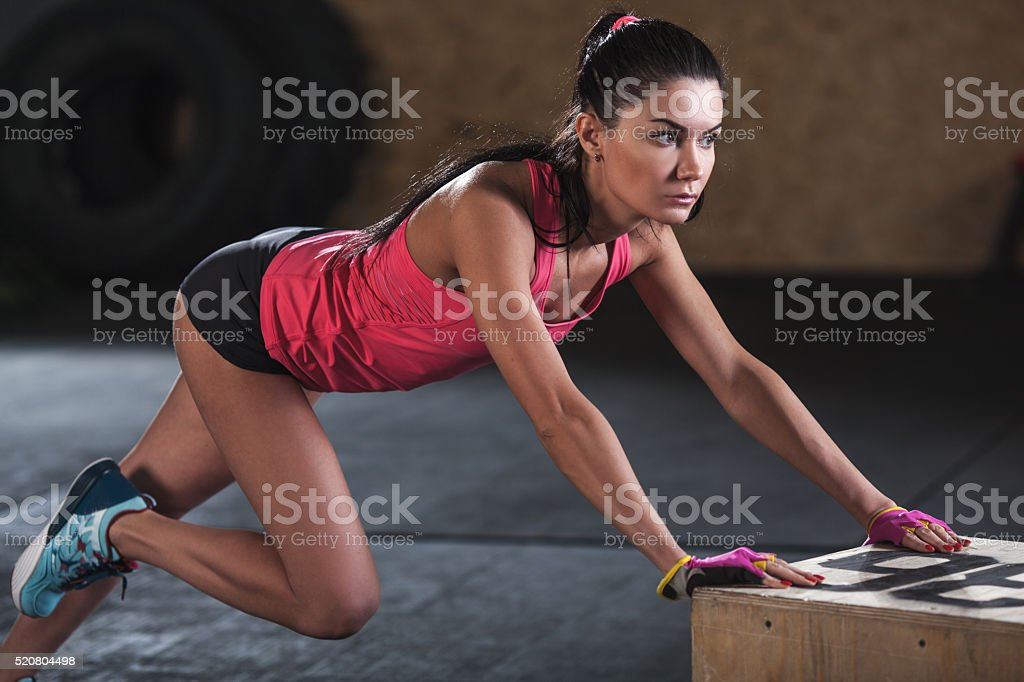 woman doing workout in  the gym stock photo