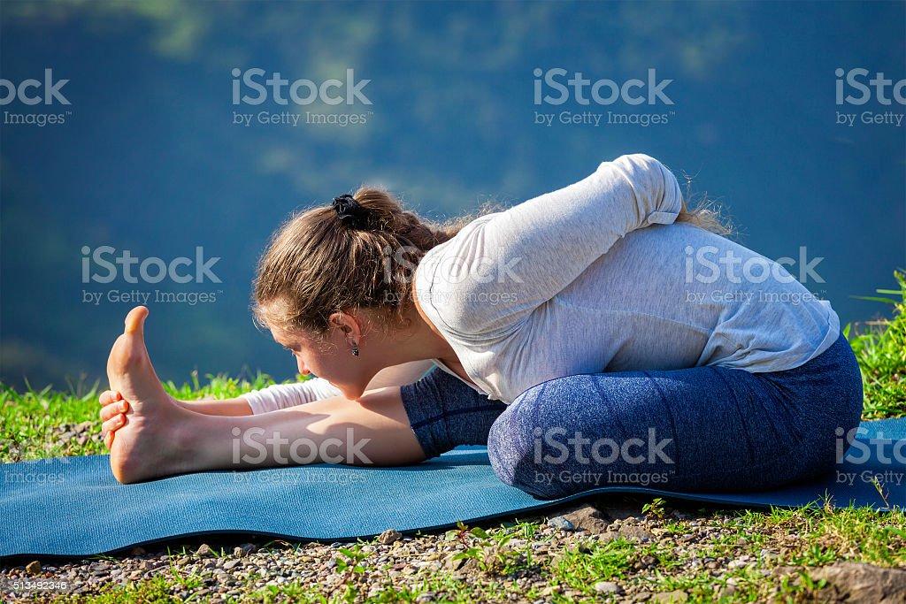 Woman doing yoga asana outdoors stock photo