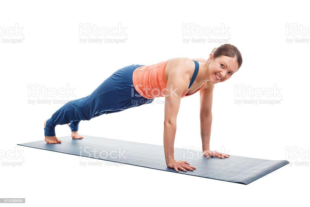 Woman doing yoga asana Utthita chaturanga dandasana (or phalakasana) stock photo