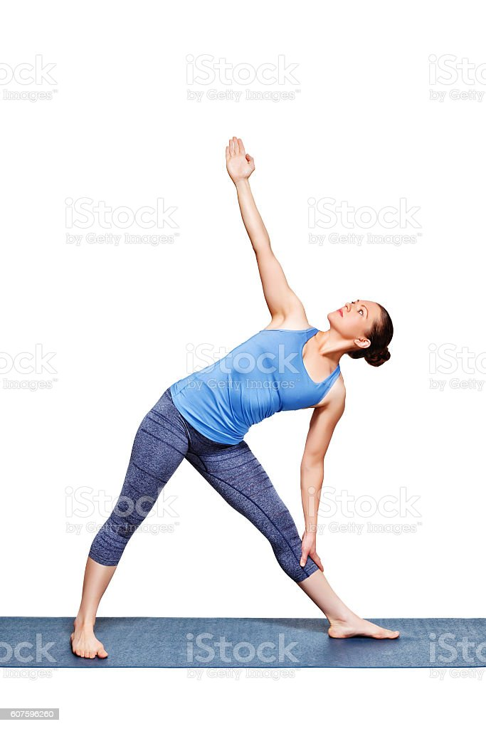 Woman doing yoga asana utthita trikonasana - extended triangle pose stock photo