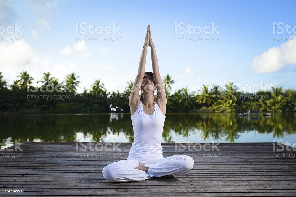 Woman Doing Yoga At Lakeside royalty-free stock photo