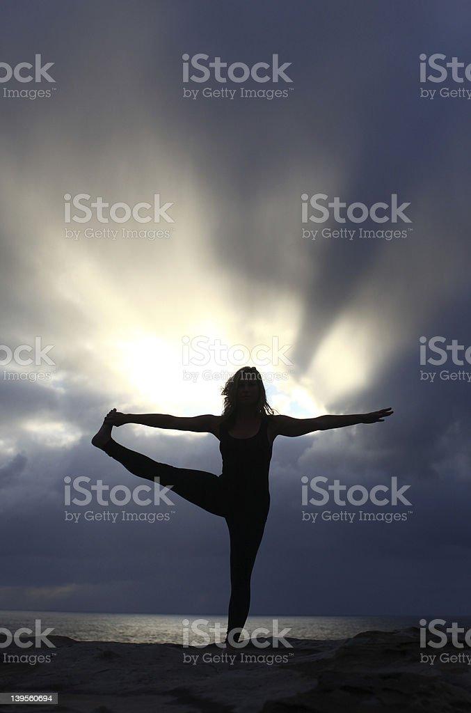 Woman Doing Yoga At Sunrise royalty-free stock photo
