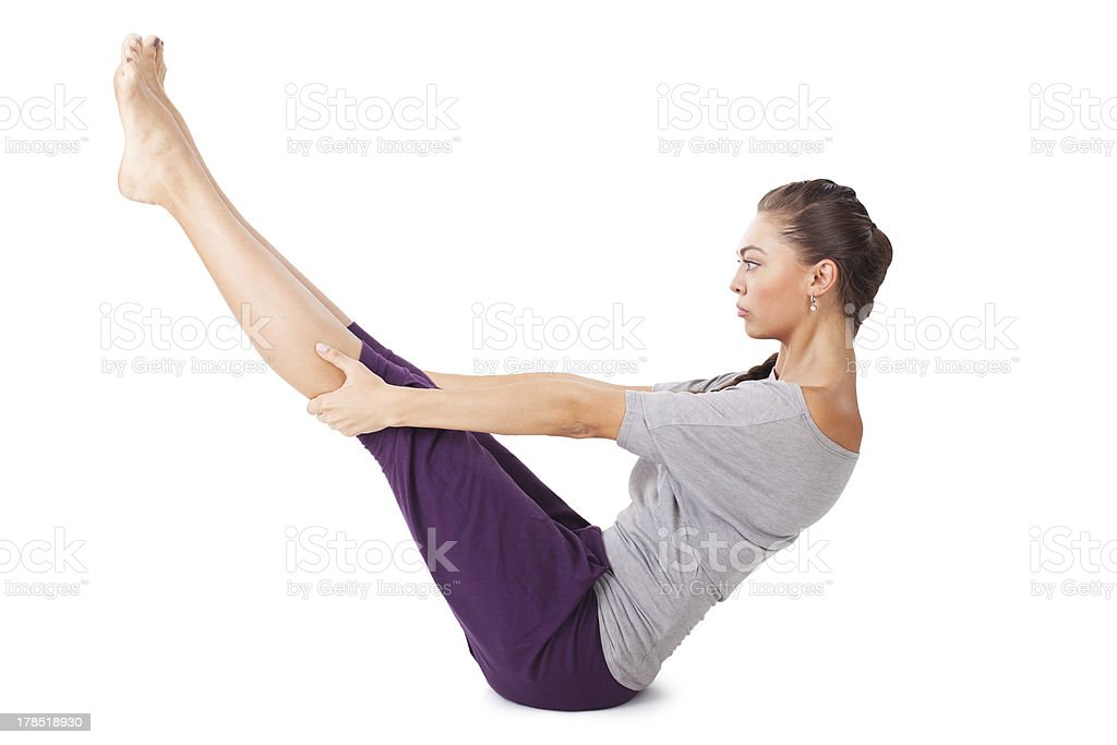 woman doing yoga exercise Full Boat Pose. Paripurna navasana royalty-free stock photo