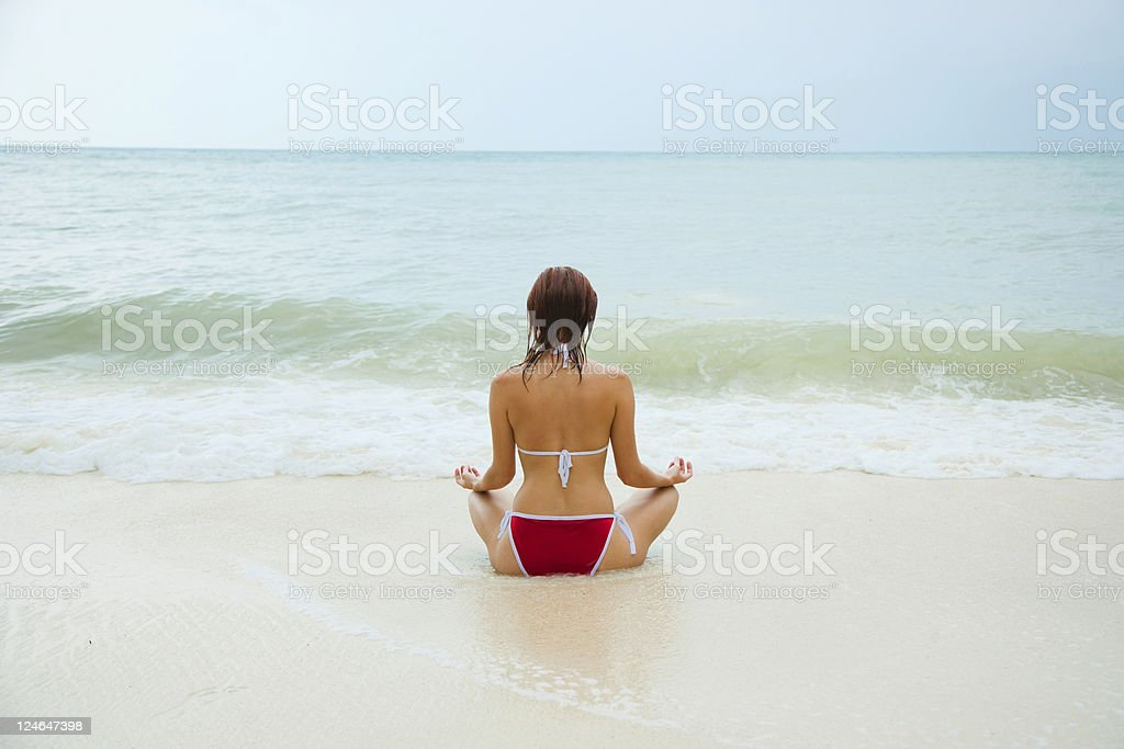 Woman doing yoga exercise outdoors royalty-free stock photo