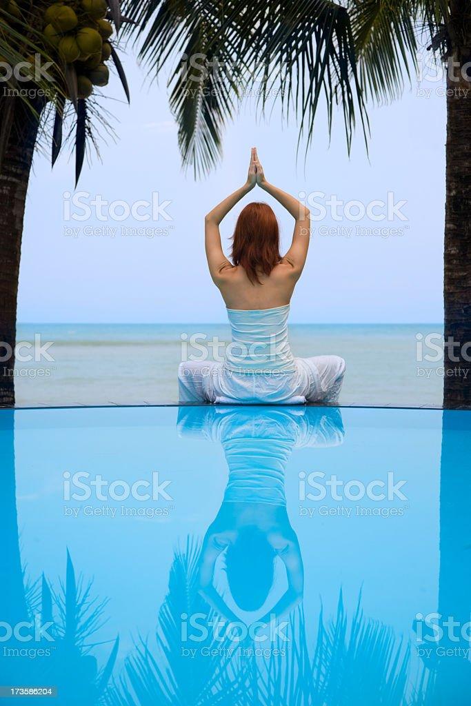 Woman doing yoga exercise outdoors royalty-free stock photo