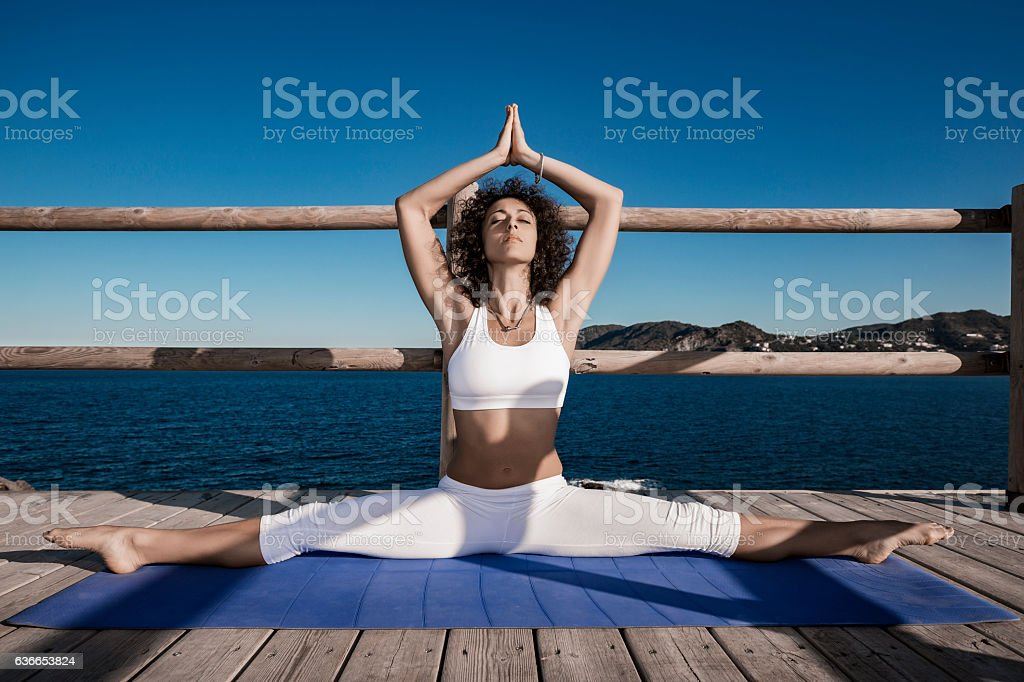 Woman doing yoga exercises stock photo