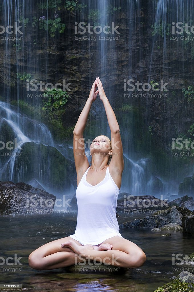 Woman doing yoga in a water pool royalty-free stock photo