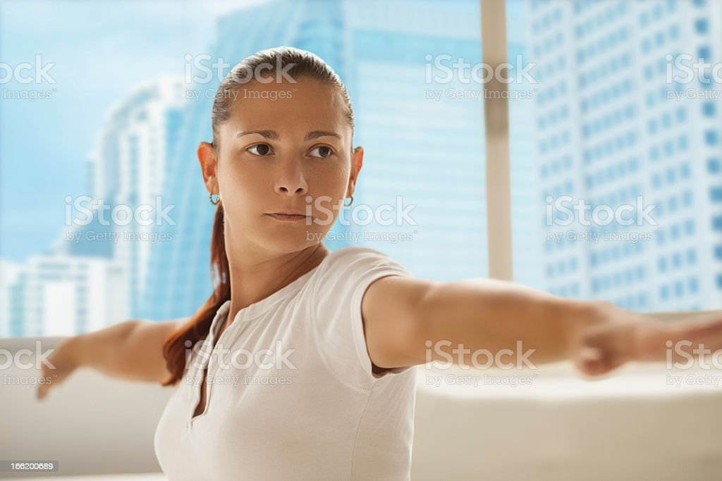 Woman doing yoga in room with view royalty-free stock photo